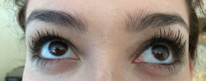 My model has regular mascara on the left side and one coat of the old formula on the right side. When I use a demo mascara with disposable wands you don't get the full results, but you can definitely see the difference!